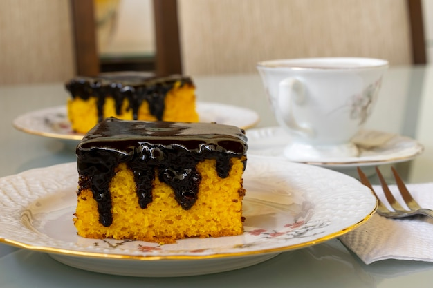 Carrot cake with chocolate icing for afternoon snack. selective focus