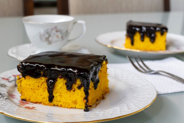 Carrot cake with chocolate icing. selective focus