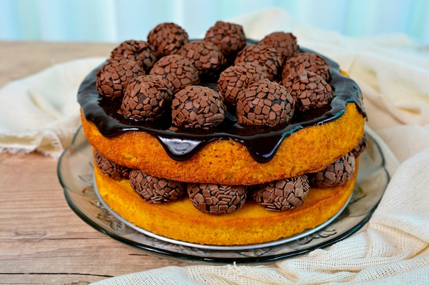 Carrot cake with chocolate topping on a rustic and beautiful table