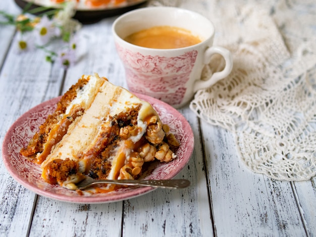 Carrot cake with salted caramel and cheesecake inside, decorated with popcorn and caramel