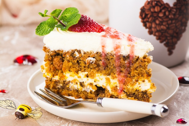 Carrot cake with strawberry sauce