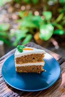 Carrot cake on a wooden table in the garden