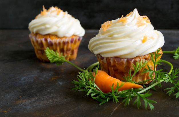 Carrot cupcakes with cream.