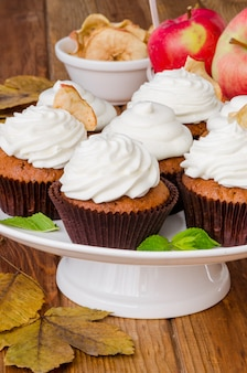 Carrot cupcakes with walnuts and butter cream on top