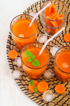 Carrot juice with ice and mint, top view