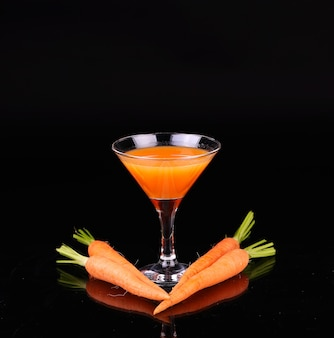 Carrots and juice in a glass