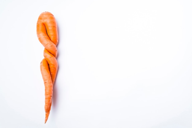 Carrots of unusual shape on a white background