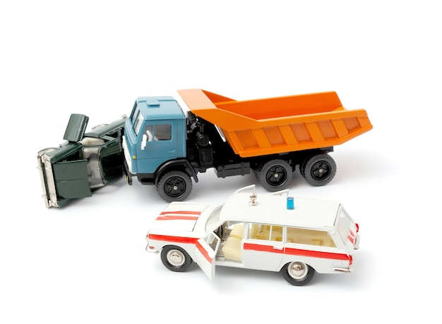 Cars in accident on a white background and ambulance car