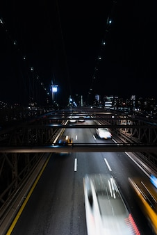 Cars on bridge at night with motion blur