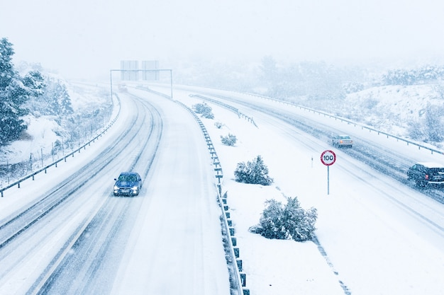 Cars driving on a snowy road.