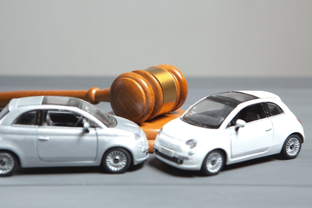 Cars and the judges hammer. concept litigation after accident
