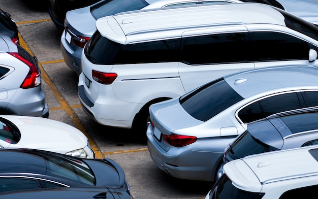 Cars parked at parking lot of the airport for rental