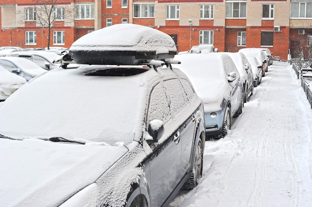 Cars in snow are parked in the yard