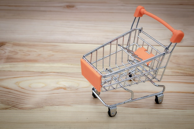 A cart on a wooden background