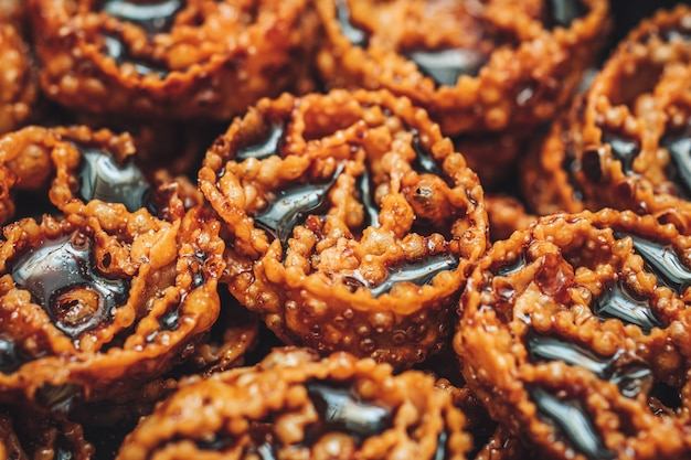 Cartellate, a delicious traditional pastry from puglia, filled with fig syrup