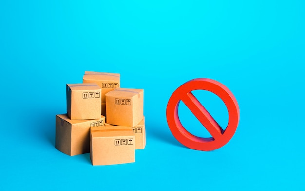 Carton boxes of goods and a red prohibition sign no protection of national manufacturers