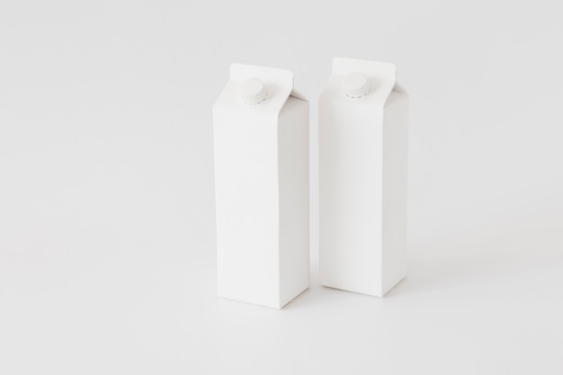 Carton containers for dairy produce