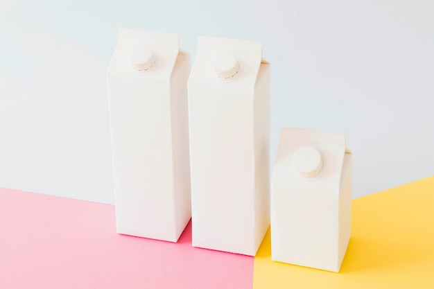 Carton milk packages on bright board