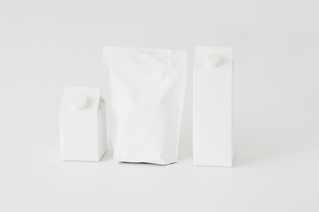 Carton and paper packages and bottles for dairy produce