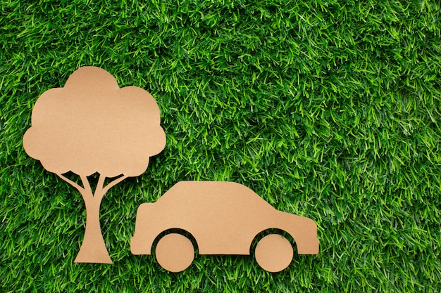 Cartoon car and tree in grass