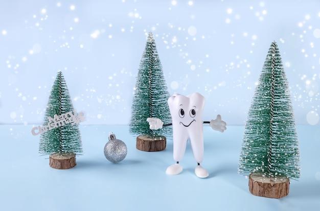 ボールと碑文メリークリスマスと歯のクリスマスツリーの漫画モデル