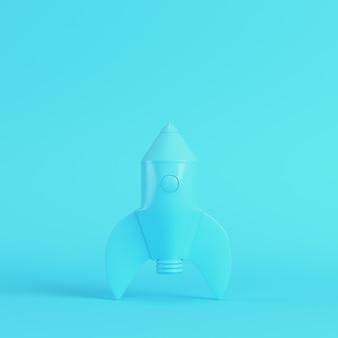 파스텔 색상의 밝은 파란색 배경에 만화 스타일 로켓. 미니멀리즘 개념입니다. 3d 렌더링