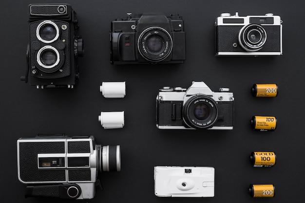 Cartridges near cameras on black background