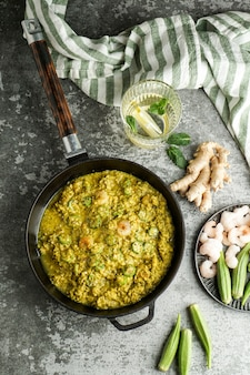 Caruru, traditional afro-brazilian dish made with okra and dried shrimp, tomatoes., cashews and peanuts