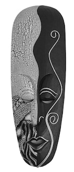 The carved african wooden mask on the white