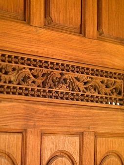 Carved wood panel wall in Bali