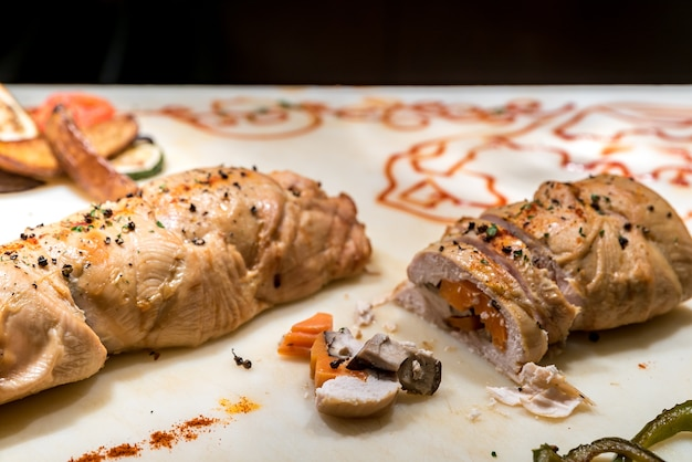 Carving of stuffed chicken breast