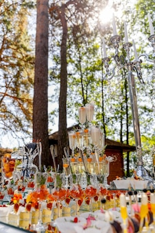Cascade of champagne glasses. pyramid of glasses for champagne or drinks. vacation at the party. catering table with snacks.