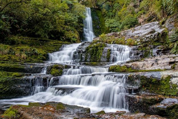 Cascade of powerful flowing waterfall