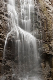 Cascading waterfall over steep rock face