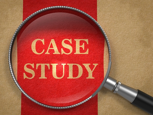 Case study concept. magnifying glass on old paper with red vertical line background.