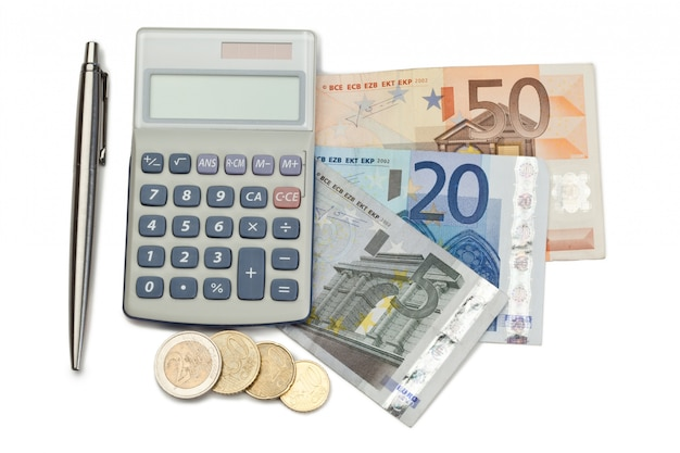 Cash and coins with pen and pocket calculator