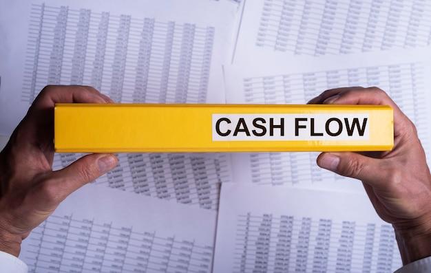 Cash flow statement on folder on office desk cashflow