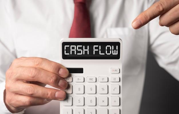 Cash flow word on calculator, cashflow inscription.