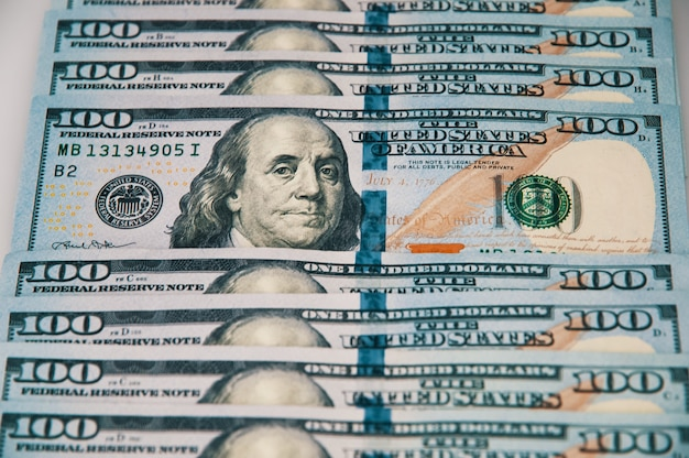 Cash hundred dollar bills, dollar background image. a row of one hundred american banknotes.