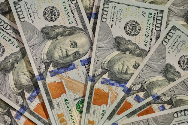 Cash of hundred dollar bills financial business investment and economical concept money background