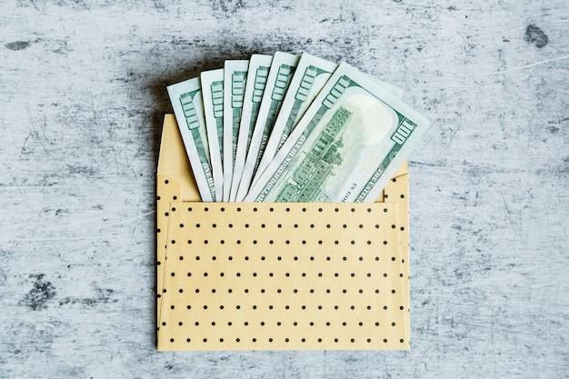 Cash money in envelope
