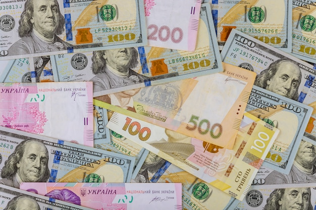 Cash money finance investment american dollars banknotes and ukrainian money.