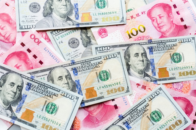 Cash money: one hundred american dollars and one hundred chinese yuan