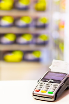 Cash register pos terminal for payments in a store close-up