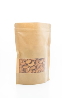 Cashew nuts in bag isolated on white background
