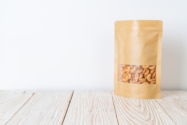 Cashew nuts in bag on wood