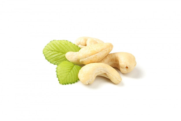 Cashew nuts and leaves isolated on white