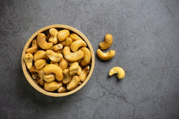 Cashew nuts with salt in bowl on table