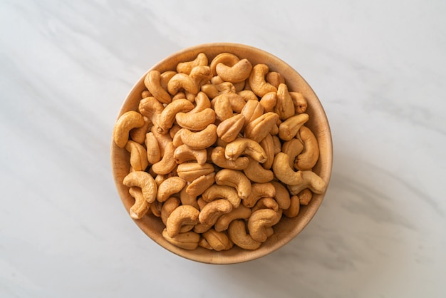 Cashew nuts in wooden bowl with copy space