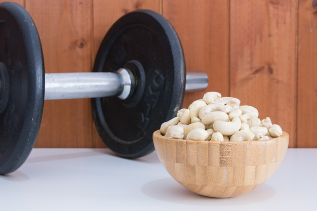 Cashews with a dumbbell behind